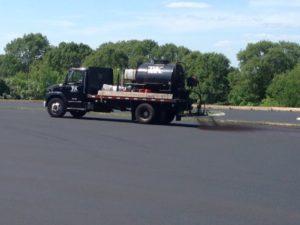 101 Sealcoat Spraying Sealer From Truck
