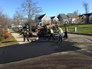 101 Overlay Big Paver With Crew On Corner
